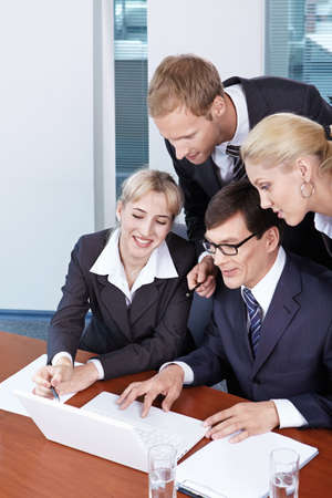 Four business people to discuss any issue in the office photo