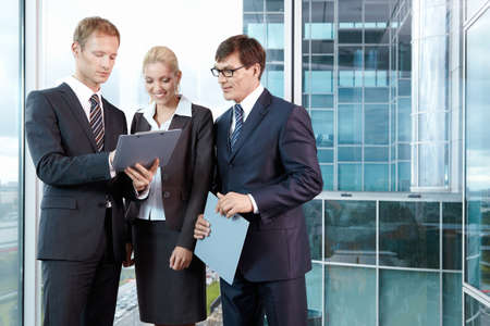 Three young men in business suits in the office Stock Photo - 7952605