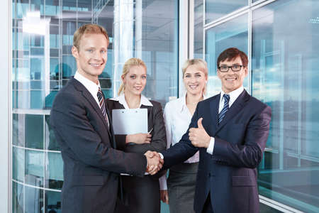concluding: Businessmen shake hands after concluding a successful transaction Stock Photo