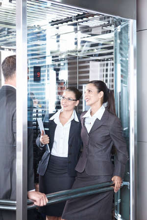 Business people traveling in an elevator photo