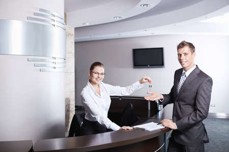 The girl at the reception gave the key businessman Stock Photo - 7945064