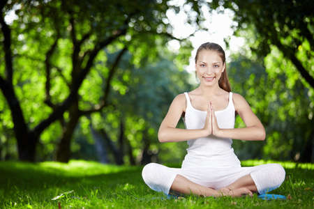 Woman in yoga pose in the park photo