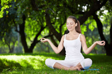 A pretty young girl in lotus position photo