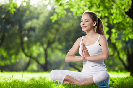 A young girl in one of the yoga postures Stock Photo