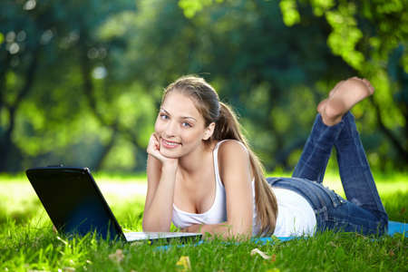 barefoot teens: Funny girl with a laptop in the park