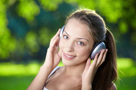 Portrait of a young girl listening to music with headphones photo