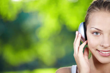 A pretty young girl with headphones photo