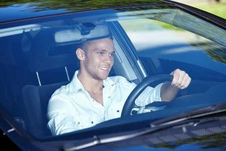 The young man driving a nice car Stock Photo - 7944858