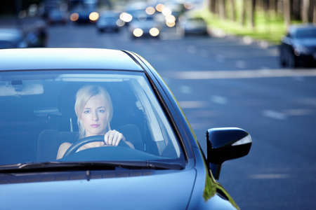 Girl in a car traveling on a busy highway photo