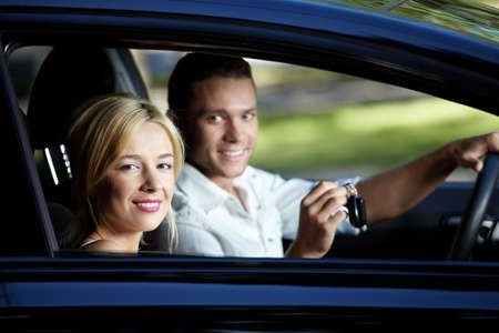 Young attractive couple in the car Stock Photo - 7945134