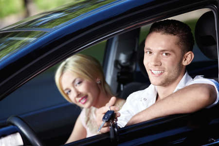 The happy couple with the keys in the car Stock Photo - 7944864
