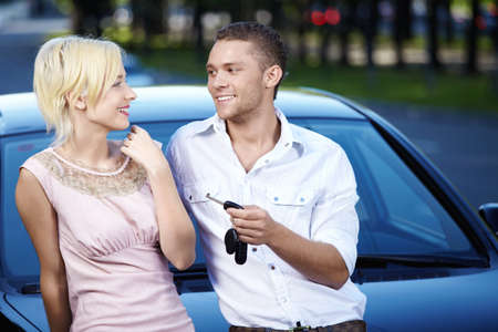 Young couple in love with the car keys photo