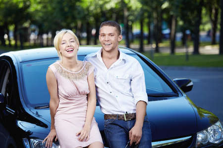 woman driving car: Young couple laughing in car