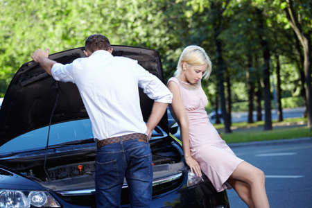 job engine: Young couple in a broken car Stock Photo