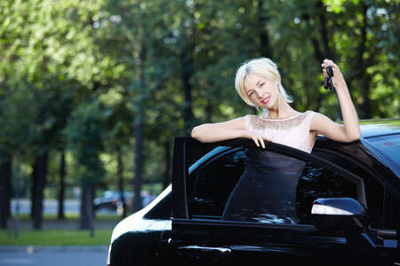 Attractive girl with the keys in car photo