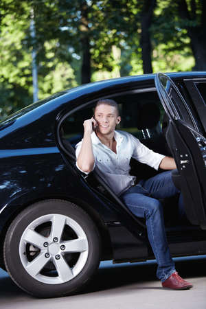 A young man talking on the phone in the car photo