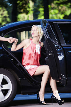 Young attractive girl out of the car photo