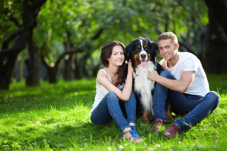 A nice couple with a dog in the park photo