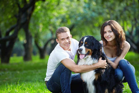 Love Couple with dog in park photo
