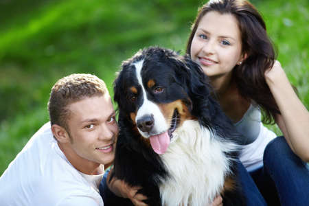 Portrait of a young couple with a dog photo
