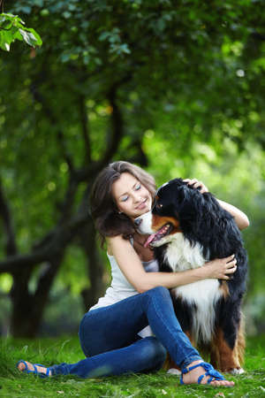 Attractive young girl playing with dog photo