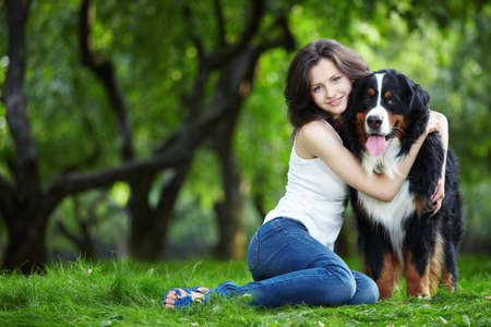 dog park: Young girl with a dog in the park Stock Photo