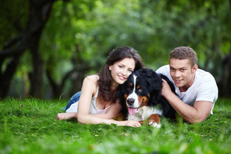 summer dog: Young couple with a dog in the park