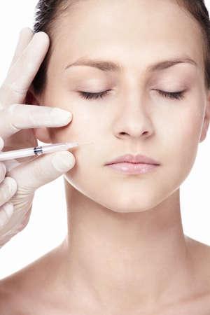 makes: A girl makes a procedure Botox