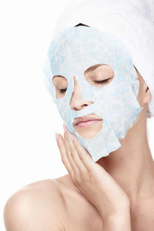 facial mask: Young girl in a cosmetic mask on a white background