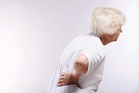 impairment: Mature woman holding his sore back