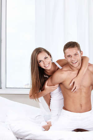Young attractive couple in the bedroom Stock Photo