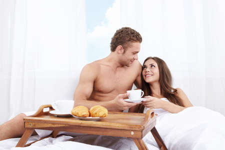 A man brought breakfast in bed girl photo