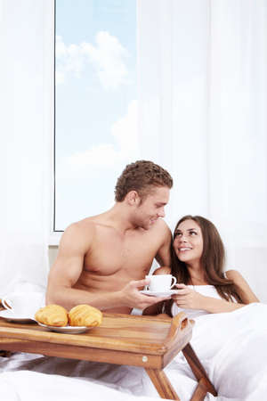 The young man brought breakfast in bed girl photo