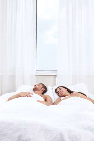 Young couple asleep in bed photo