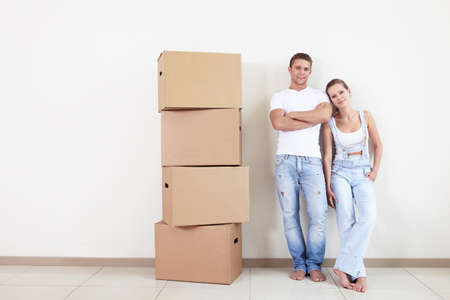 An attractive couple with boxes in new home photo