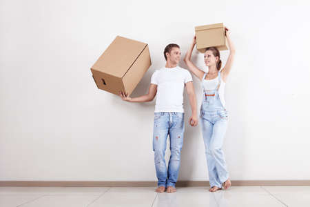 Attractive couple in the apartment with boxes photo
