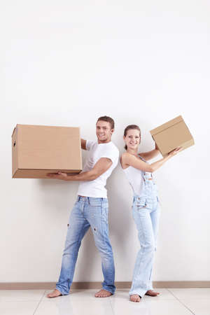 Young couple in a new apartment with boxes photo