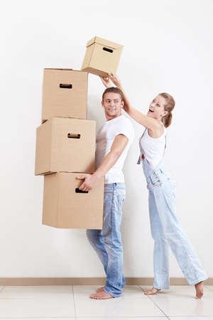 Young girl puts a box man photo