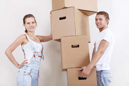 Young attractive couple with cardboard boxes photo