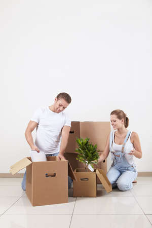 Young attractive couple unpacked photo