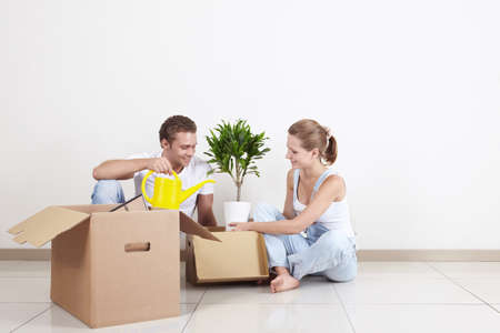 unpacked: Young couple unpacked on the floor Stock Photo