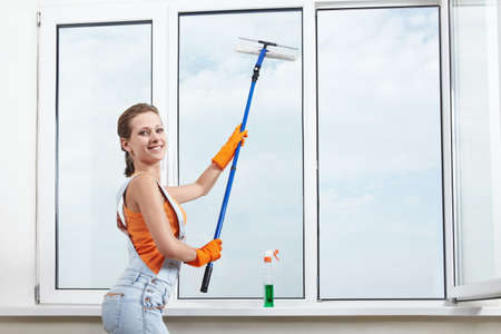 The girl washing windows mop for washing windows Stock Photo - 7944805
