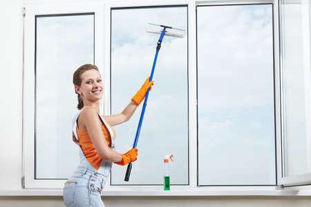 The girl washing windows mop for washing windows photo