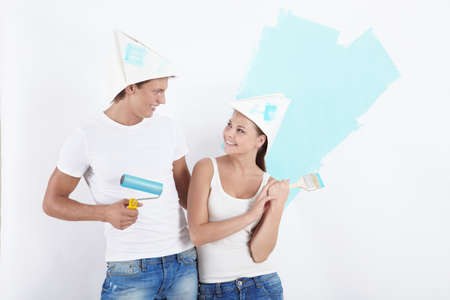 home repairs: Young people make home repairs Stock Photo