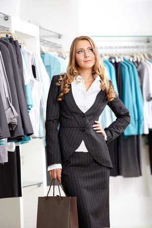 The nice young girl in clothes shop Stock Photo - 7994867