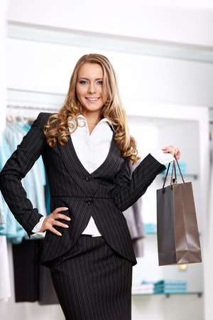 personal shopper: The smiling girl with a bag in clothes shop