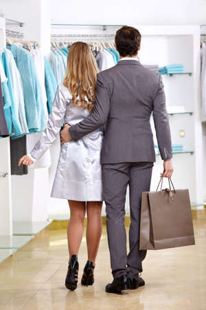 The couple goes on shop of clothes with purchases photo