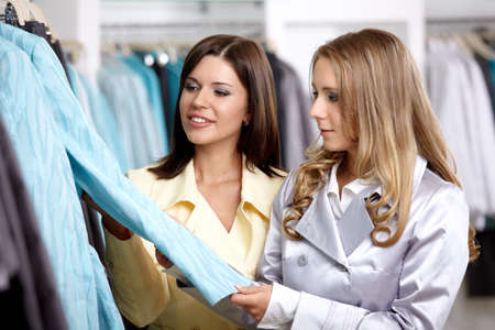 personal shopper: Two nice girls consider clothes in shop