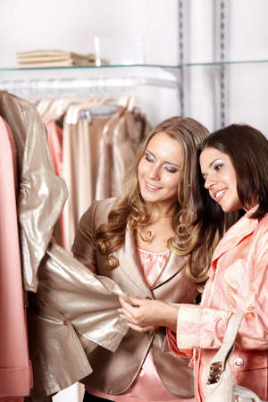 personal shopper: Two young girls consider clothes in shop