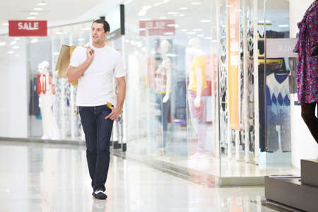 mall: A young man goes shopping with the store Stock Photo